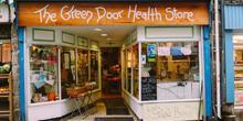 shop front view of The Green Door Health Store