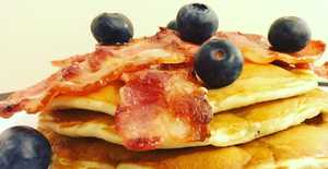 Presentation photo of Blueberry and bacon pancakes