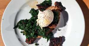 Presentation photo of Poached eggs with kale and chorizo